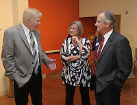NWA Democrat-Gazette/ANDY SHUPE<br /> Loyd Phillips (from left) speaks with Karen and Charles Smith Thursday, Oct. 29, 2015, before the start of the Springdale Public Schools Education Foundation Cornerstone Society induction ceremony at the Arts Center of the Ozarks in Springdale. Visit nwadg.com/photos to see more photographs from the evening.
