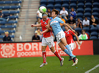 Chicago midfielder Megan Rapinoe (7) heads a shot on goal while being defended by Washington defender Becky Sauerbrunn (22).  The Chicago Red Stars defeated the Washington Freedom 2-1 at Toyota Park in Bridgeview, IL on September 5, 2010.