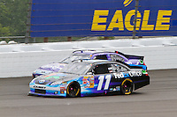 19 June, 2011: Denny Hamlin passes Matt Kenseth out of turn two during the 43rd Annual Heluva Good! Sour Cream Dips 400 at Michigan International Speedway in Brooklyn, Michigan. (Photo by Jeff Speer :: SpeerPhoto.com)