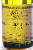 Closeup close-up of a wine bottle label Maison Domaine des Heritiers Louis Jadot Bourgogne Corton Charlemagne Grand Cru Appellation Controlee backlit backlight back lit light white, Maison Louis Jadot, Beaune Côte Cote d Or Bourgogne Burgundy Burgundian France French Europe European