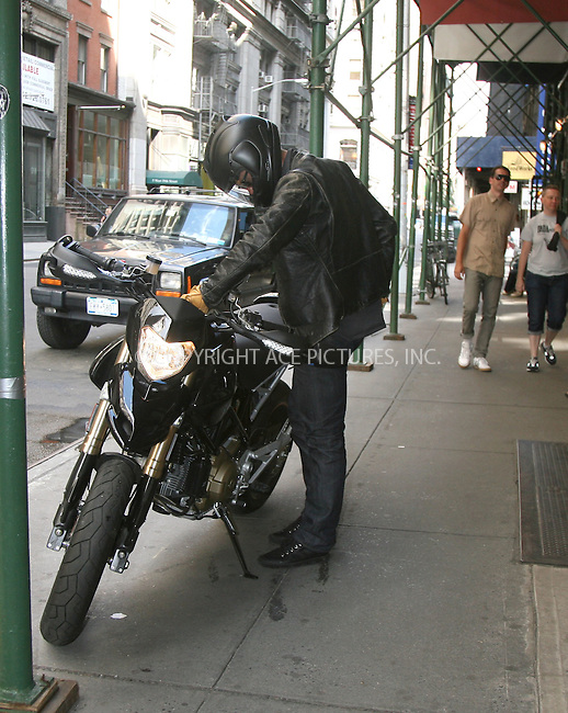 WWW.ACEPIXS.COM ************....July 14 2009, New York City....**EXCLUSIVE - ALL ROUNDER**....Bristish actor Orlando Bloom managed to break four New York City laws as he arrives back at his Manhattan apartment. Arriving on his new $15,000 Ducati Hypermotard 1100s he proceeded to ride it onto the sidewalk, remove the number plate and registration sticker and then leave it parked on the sdiewalk. ....Please byline: PHILIP VAUGHAN - ACEPIXS.COM.. *** ***  ..Ace Pictures, Inc:  ..tel: (646) 769 0430..e-mail: info@acepixs.com..web: http://www.acepixs.com