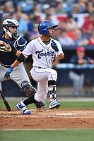 Asheville Tourists shortstop Carlos Herrera (2) swings at a pitch during a game against the Charleston RiverDogs at McCormick Field on July 4, 2017 in Asheville, North Carolina. The Tourists defeated the RiverDogs 2-1. (Tony Farlow/Four Seam Images)