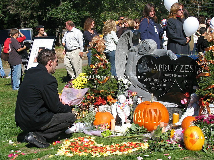 WOLCOTT, CT - 4 Oct. 2008 - 100408AL02 - An unidentified man gazes at the headstone of Anthony and Jessica Apruzesse, who were killed in a car accident last October.