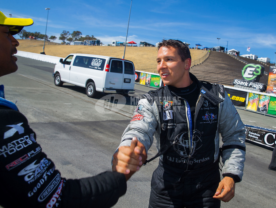 Aug 2, 2015; Sonoma, CA, USA; NHRA top fuel driver Dave Connolly (right) congratulates race winner Antron Brown during the Sonoma Nationals at Sonoma Raceway. Mandatory Credit: Mark J. Rebilas-