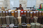 A Palestinian vendor sells spices at a market in Gaza city on Aug. 6, 2011. Muslims around the world abstain from eating, drinking and conducting sexual relations from sunrise to sunset during Ramadan, the holiest month in the Islamic calendar. Photo by Ashraf Amra