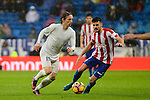 Real Madrid's player Luka Modric and Sporting de Gijon's player Sergio A. during match of La Liga between Real Madrid and Sporting de Gijon at Santiago Bernabeu Stadium in Madrid, Spain. November 26, 2016. (ALTERPHOTOS/BorjaB.Hojas)