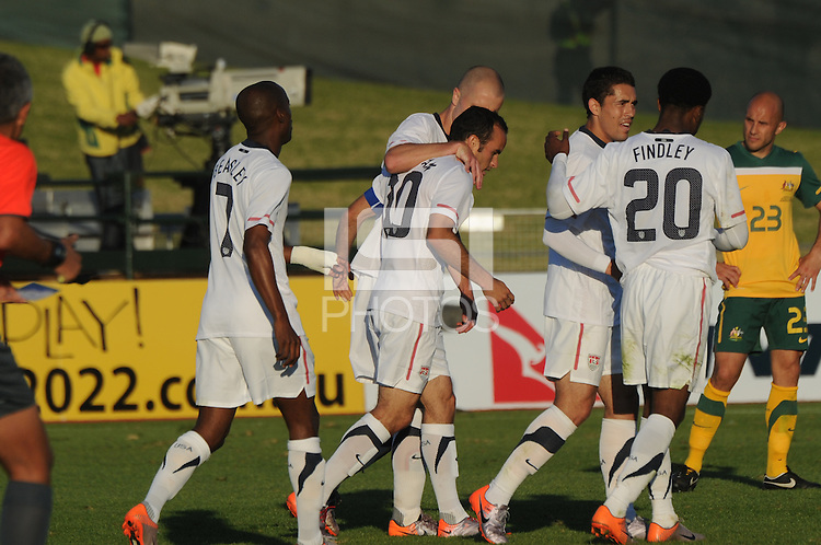 Michael Bradely congratulates Landon Donovan on the assist, and Robbie Findley congratualtes Hercules Gomez on the final U.S. goal coming in the third minute of stoppage time. The U.S. won the match over Australia, 3-1, played June 5th, in Ruimsig Stadium,  at Roodepoort, South Africa.