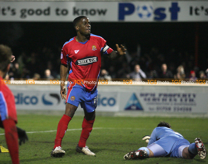Abu Ogogo of Dagenham celebrates scoring the Daggers opening goal - Dagenham and Redbridge vs Rochdale at the London Borough of Barking and Dagenham Stadium - 12/01/13 - MANDATORY CREDIT: Dave Simpson/TGSPHOTO - Self billing applies where appropriate - 0845 094 6026 - contact@tgsphoto.co.uk - NO UNPAID USE.