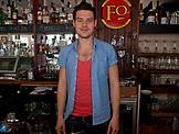 ENGLAND, Brighton, a Waiter in a Bar