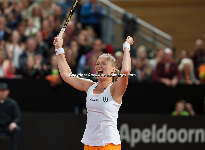 Februari 08, 2015, Apeldoorn, Omnisport, Fed Cup, Netherlands-Slovakia, Kiki Bertens (NED) celebrates, she puts the Netherlands in the lead 2-1<br /> Photo: Tennisimages/Henk Koster