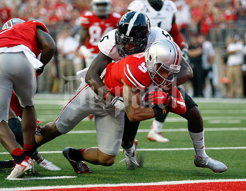 Ohio State Buckeyes wide receiver Devin Smith (9) falls into the end zone for a touchdown during the first quarter of Saturday's NCAA Division I football game at Ohio Stadium in Columbus on September 27, 2014. (Columbus Dispatch photo by Jonathan Quilter)