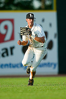 Lexington center fielder Nicholas Moresi (12) makes a running catch versus West Virginia at Applebee's Park in Lexington, KY, Thursday, June 7, 2007.