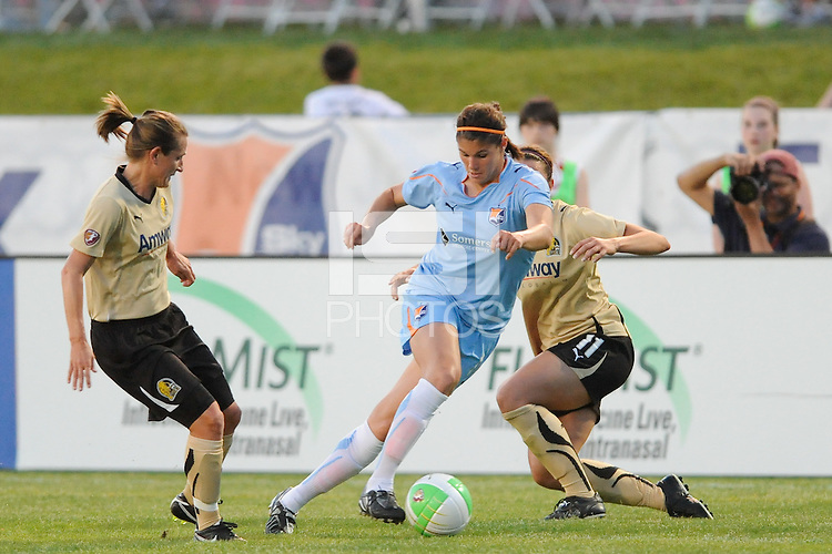 Brittany Taylor (14) of Sky Blue FC splits Tiffeny Milbrett (15) and Kiki Bosio (11)  of FC Gold Pride. FC Gold Pride defeated Sky Blue FC 1-0 during a Women's Professional Soccer (WPS) match at Yurcak Field in Piscataway, NJ, on May 1, 2010.