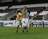 Jon Scullion shielding the ball from Calum Waters in the St Mirren v Celtic Scottish Professional Football League Under 20 match played at St Mirren Park, Paisley on 30.4.14.