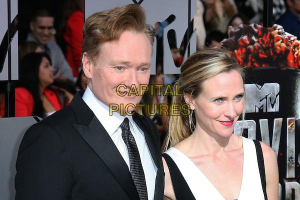 13 April 2014 - Los Angeles, California - Conan O&rsquo;Brien, Liza Powel O'Brien. 2014 MTV Movie Awards held at Nokia Theatre L.A. Live. <br /> CAP/ADM<br /> &copy;AdMedia/Capital Pictures