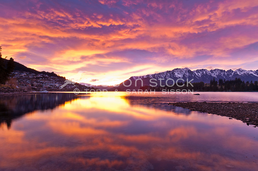 Sunrise over the Remarkables mountains reflected in Lake Wakatipu, Central Otago, South Island, New Zealand