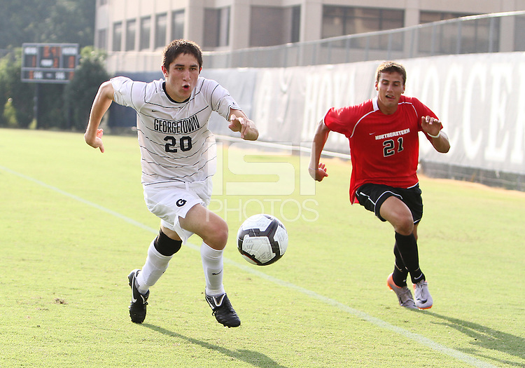 Andy Riemer #20 of Georgetown University races away from Josh Semerene #21 of Northeastern University during an NCAA match at North Kehoe Field, Georgetown University on September 3 2010 in Washington D.C. Georgetown won 2-1 AET.
