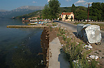 Tushemisht-Pogradec-Albania - August 02, 2004---Waste container at the shore of Lake Ohrid; region/village of project implementation by GTZ-Wiram-Albania (German Technical Cooperation, Deutsche Gesellschaft fuer Technische Zusammenarbeit (GTZ) GmbH); infrastructure-environment-pollution---Photo: Horst Wagner/eup-images