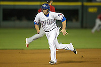 Round Rock Express first baseman Chis Gimenez #4 runs to third base during the Pacific Coast League baseball game against the Memphis Redbirds on April 24, 2014 at the Dell Diamond in Round Rock, Texas. The Express defeated the Redbirds 6-2. (Andrew Woolley/Four Seam Images)