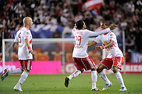 Dane Richards (19) of the New York Red Bulls celebrates a goal with Luke Rodgers (9) and Roy Miller (7). The New York Red Bulls defeated the Philadelphia Union  1-0 during a Major League Soccer (MLS) match at Red Bull Arena in Harrison, NJ, on October 20, 2011.
