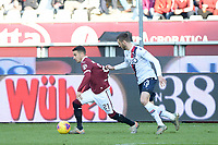 12th January 2020; Olympic Grande Torino Stadium, Turin, Piedmont, Italy; Serie A Football, Torino versus Bologna; Alejandro Berenguer of Torino FC is fouled as he is held by Mattia Bani of Bologna FC - Editorial Use