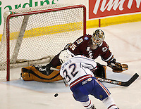 Jun 7, 2007; Hamilton, ON, CAN; Hamilton Bulldogs center (32) Ajay Baines scores the shorthanded game winning goal on Hershey Bears goalie (35) Frederic Cassivi during the third period of game five of the Calder Cup finals at Copps Coliseum. The Bulldogs defeated the Bears 2-1 to win the Calder Cup. Mandatory Credit: Ron Scheffler