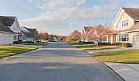 Repetitive Community Housing on a Manicured Suburban Street