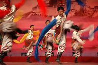 Tibetan dancers perform traditional tribal dances in Lhasa.