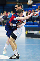 06 APR 2012 - LONDON, GBR - Great Britain's Chris Mohr (GBR) finds his run to goal halted as he is lifted from the ground by Tunisia's Mahmoud Gharbi (TUN) during the men's 2012 London Cup match at the National Sports Centre in Crystal Palace, Great Britain .(PHOTO (C) 2012 NIGEL FARROW)