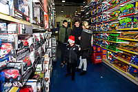 Pictured: Cameron Carter-Vickers and Tom Carroll of Swansea City buying children gifts at Smyth's Toy Store, in Swansea, Wales, UK. Wednesday 19 December 2018