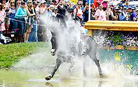 LEXINGTON, KENTUCKY - APRIL 29: Cooley Cross Border #51, with rider Kim Severson (USA), make a splash at the Head of the Lake during the Cross Country Test at the Rolex Kentucky 3-Day Event at the Kentucky Horse Park on April 29, 2017 in Lexington, Kentucky. (Photo by Scott Serio/Eclipse Sportswire/Getty Images)