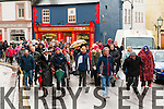 Post Office Protest :  Billy Keane & Jackie McGillacuddy lead  the crowd   against the moving of Listowel post office  from William St. at a protest march  on Saturday last.