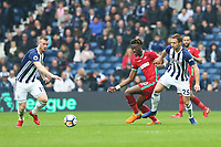Tammy Abraham of Swansea City is challenged by Craig Dawson of West Bromwich Albion during the Premier League match between Swansea City and West Bromwich Albion at the Hawthorns Stadium, Birmingham, England, UK. Saturday 07 April 2018