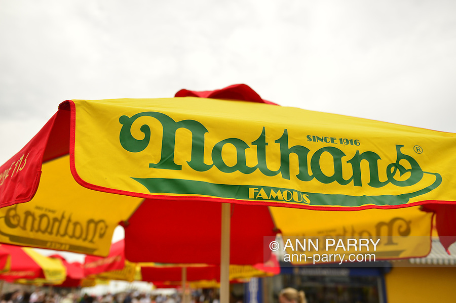 Brooklyn, New York, USA. 10th August 2013. Closeup of Nathans Famous umbrella, in red, yellow and green, on the boardwalk,  during the 3rd Annual Coney Island History Day celebration.
