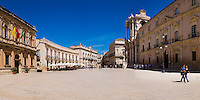 Panoramic photo of Piazza Duomo, on the right is Duomo di Siracusa (aka Syracuse Cathedral or The Temple of Athena), Ortigia, Syracuse (Siracusa), UNESCO World Heritage Site, Sicily, Italy, Europe. This is a panoramic photo of Piazza Duomo. On the right is Duomo di Siracusa (aka Syracuse Cathedral or The Temple of Athena), Ortigia, Syracuse (Siracusa), UNESCO World Heritage Site, Sicily, Italy, Europe.