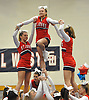 St. John the Baptist cheerleaders, from left, Christina Smith, Sarah Giancola and Katie Brzostek perform with their squad during an invitational competition held at Smithtown High School West on Saturday, Dec. 17, 2016.