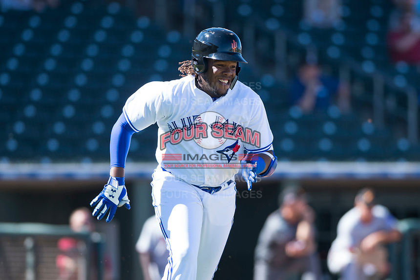 Surprise Saguaros third baseman Vladimir Guerrero Jr. (27), of the Toronto Blue Jays organization, hustles towards first base during an Arizona Fall League game against the Salt River Rafters on October 9, 2018 at Surprise Stadium in Surprise, Arizona. The Rafters defeated the Saguaros 10-8. (Zachary Lucy/Four Seam Images)