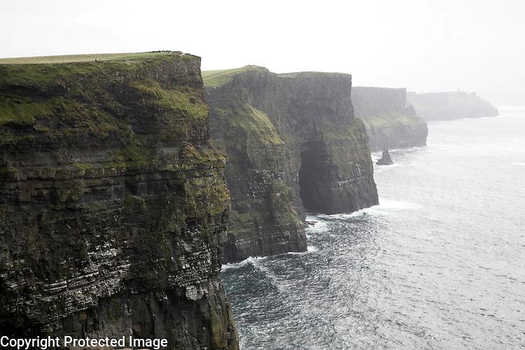 Near vertical cliff face over 200 metres high, Cliffs of Moher, Atlantic Coast, County Clare, Ireland