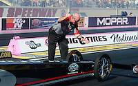 Oct. 27, 2012; Las Vegas, NV, USA: NHRA crew member for top fuel driver Steve Torrence during qualifying for the Big O Tires Nationals at The Strip in Las Vegas. Mandatory Credit: Mark J. Rebilas-