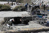 Pictured: A disabled refugee man rests on the ground at the Helliniko camp Friday 26 February 2016<br />Re: Refugees have been turning up at the Helliniko refugee camp in the outskirts of Athens, Greece.
