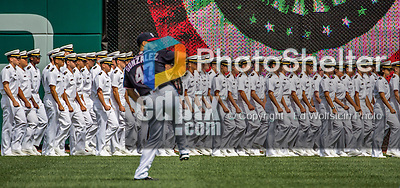 11 September 2016: Over 1000 USNA Midshipmen march on the field as Washington Nationals pitcher Gio Gonzalez warms up prior to a game between the Philadelphia Phillies and the Washington Nationals as part of Heroes Day at Nationals Park in Washington, DC. The Nationals edged out the Phillies 3-2 to take the rubber match of their 3-game series. Mandatory Credit: Ed Wolfstein Photo *** RAW (NEF) Image File Available ***