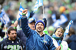Seattle Seahawks 12th Man fans participate in pre game ceremonies taking the field against the St. Louis Rams at CenturyLink Field in Seattle, Washington on December 27, 2015.  The Rams beat the Seahawks 23-17.      ©2015.  Jim Bryant Photo. All Rights Reserved
