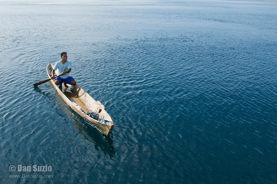 Local resident paddles a canoe near Beloi, Atauro Island, Timor-Leste (East Timor)