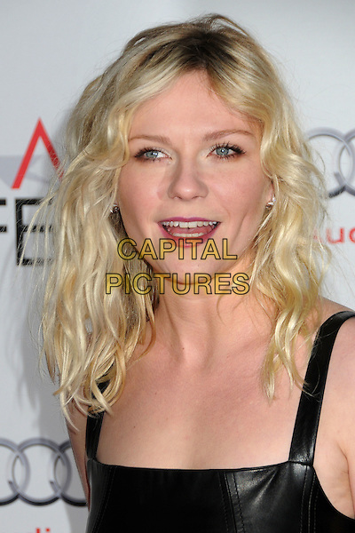 Kirsten Dunst.AFI Fest 2011 - Los Angeles Time Young Hollywood Panel held at Grauman's Chinese Theatre, Hollywood, California, USA..November 4th, 2011.headshot portrait black leather sleeveless  red lipstick wavy hair mouth open .CAP/ADM/BP.©Byron Purvis/AdMedia/Capital Pictures.