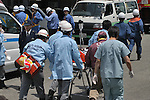 10th Anniversary File Photo: Rescue workers assist a surviving passenger from a train that crashed into a building in Amagasaki, Japan on April 25, 2005. 107 people were killed in the accident, 562 were injured.<br /> <br /> The accident was Japan's most serious since a train accident in 1963 killed 162 people. (Photo by Duits.co/AFLO)