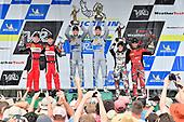 #14 3GT Racing Lexus RCF GT3, GTD: Dominik Baumann, Kyle Marcelli, #58 Wright Motorsports Porsche 911 GT3 R, GTD: Patrick Long, Christina Nielsen, #86 Michael Shank Racing with Curb-Agajanian Acura NSX, GTD: Katherine Legge, Mario Farnbacher, celebrate the win on the podium