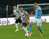 Arturo Vidal  Gokhan Inler    in action during the Italian Serie A soccer match between SSC Napoli and Juventus FC   at San Paolo stadium in Naples, March 30 , 2014