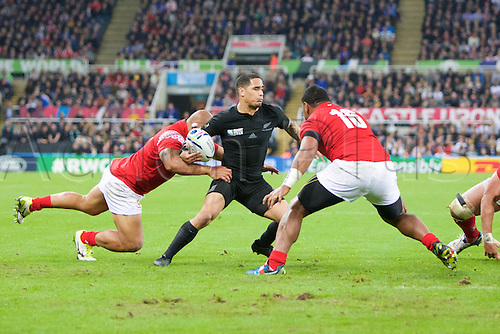 09.10.2015. St James Park, Newcastle, England. Rugby World Cup. New Zealand versus Tonga. New Zealand All Black scrum-half Aaron Smith is tackled by Tonga hooker Paula Ngauamo.