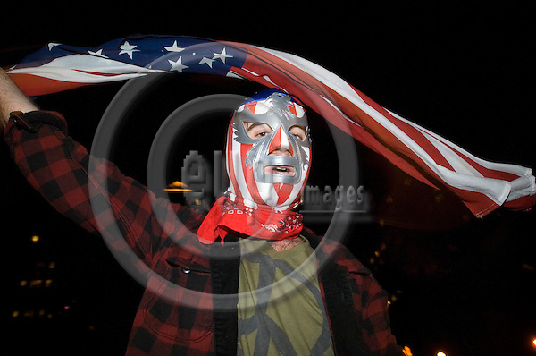 NEW YORK - USA 5 NOV 2008 -- At Union Square, New York a crowd is celebrating the elected president Barack Obama. A man with a mask decorated as the American flag swings the flag. -- PHOTO: © GORM K. GAARE/ EUP-BERLIN..
