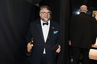 Guillermo del Toro poses backstage with the Oscar&reg; for achievement in directing for work on &ldquo;The Shape of Water&rdquo; during the live ABC Telecast of The 90th Oscars&reg; at the Dolby&reg; Theatre in Hollywood, CA on Sunday, March 4, 2018.<br /> *Editorial Use Only*<br /> CAP/PLF/AMPAS<br /> Supplied by Capital Pictures